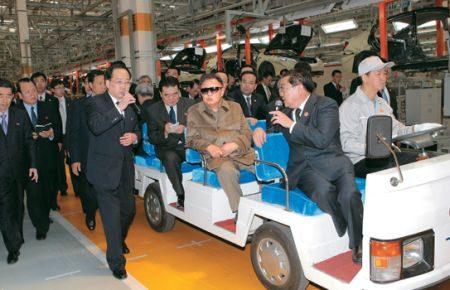 Kim Jong-il looking at a car factory